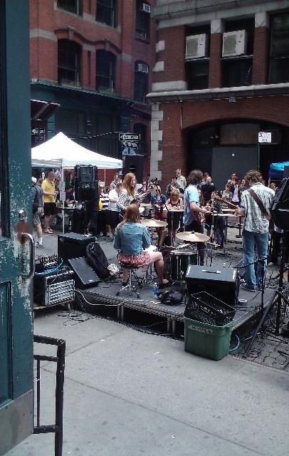 live music outside at the housing works street fair